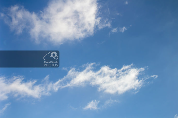 A fun fish cloud and wave cloud photo with a tranquil blue sky for your digital projects.